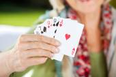 Senior Woman Showing Playing Cards — Photo