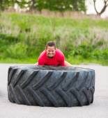 Dedicated Woman Lifting Tire — Foto Stock