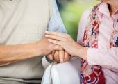 Senior Couple Holding Hands While Sitting On Chairs — Stock Photo