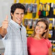 Successful Man With Woman In Hardware Store — Stock Photo #56233607