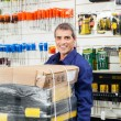 Worker With Tool Package In Hardware Shop — Stock Photo #56234605