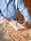 Midsection Of Carpenter Cutting Wood With Bandsaw — Stock Photo