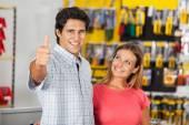 Successful Man With Woman In Hardware Store — Fotografia Stock