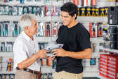 Father And Son Buying Drill In Store — Stock fotografie
