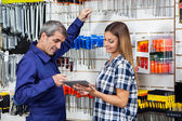 Customer Showing Digital Tablet To Vendor In Hardware Store — Stock Photo