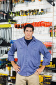 Customer With Hands On Hip In Hardware Shop — Stock Photo
