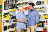 Father With Son Checking List In Hardware Store — Stock Photo