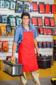 Salesman Holding Toolboxes In Hardware Shop — Stock Photo