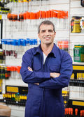 Worker With Arms Crossed In Hardware Store — Stock Photo