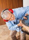 Carpenter Shaving Wood With Electric Planer — Fotografia Stock