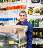 Worker With Tool Package In Hardware Shop — Stock Photo