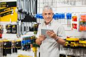 Customer Holding Digital Tablet In Hardware Store — Stock Photo