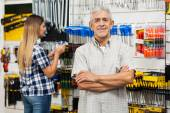 Confident Senior Man With Arms Crossed In Hardware Store — Stock Photo