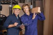 Carpenters With Clipboard And Wooden Planks — Stock Photo