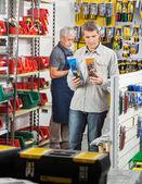 Man Choosing Soldering Iron In Store — Foto de Stock