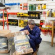 Worker Lifting Tool Package In Hardware Shop — Stock Photo #56241057