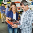 Happy Couple Buying Tool Set In Hardware Store — Stock Photo #56243607