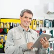 Confident Man Using Tablet Computer In Hardware Store — Stock Photo #56243825