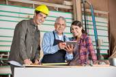 Carpenters Using Digital Tablet In Workshop — Stock Photo