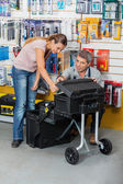 Salesman Showing Tool Case To Customer In Store — Stock Photo