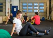 Woman Doing Relaxation Exercise In Crossfit Gym — Stock Photo