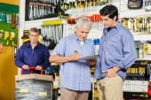 Customers Writing On Checklist In Hardware Store — Stock Photo