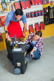 Salesman With Customer Analyzing Tool Case In Store — Stock Photo