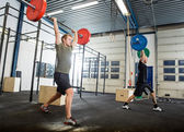 Athletes Exercising With Barbells — Stock Photo