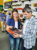 Happy Couple Buying Tool Set In Hardware Store — Stock Photo