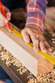 Carpenters Hand Marking On Wood In Workshop — Stock Photo