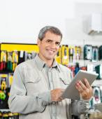 Confident Man Using Tablet Computer In Hardware Store — Stock Photo