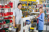 Couple Buying Tools In Hardware Store — Stock Photo