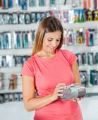 Woman Making Payment Through Smartphone In Hardware Store — Foto Stock
