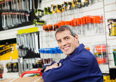 Mature Worker Leaning In Hardware Shop — Stock Photo