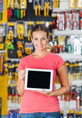 Woman Displaying Digital Tablet In Hardware Shop — Foto Stock