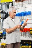 Customer Comparing Screwdrivers In Hardware Shop — Stock Photo