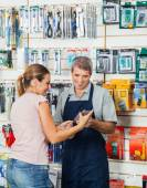 Salesman Guiding Customer In Hardware Store — Stock Photo