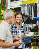 Woman With Father Holding Wrench In Shop — Stock Photo