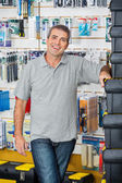 Man Standing By Stacked Toolboxes In Store — Stock Photo
