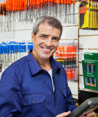 Confident Worker Holding Product In Hardware Store — Stock Photo