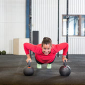 Woman Doing Pushup Exercise With Kettlebell — Photo