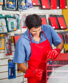 Salesman With Drill Bit And Toolbox In Store — Stock Photo
