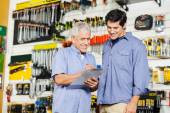 Customers Checking Checklist In Hardware Store — Stock Photo