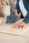 Carpenter Using Electric Planer On Wood — Stock Photo