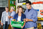 Couple Buying Tools At Hardware Store — Stock Photo
