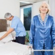 Portrait Of Senior Woman With Walking Frame At Nursing Home — Stock Photo #56615967