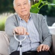 Portrait Of Elderly Man Holding Metal Walking Stick — Stok fotoğraf #56616571
