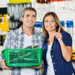 Woman Showing Something To Man In Hardware Store — Stock Photo #56616605