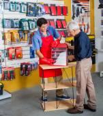 Salesman Assisting Man In Buying Tools At Store — Foto de Stock