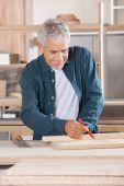 Senior Carpenter Marking On Wood With Pencil — Stock Photo